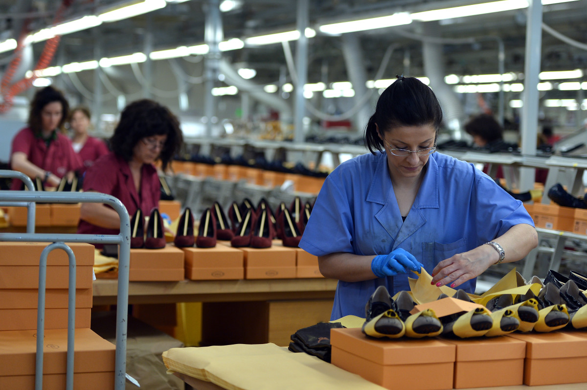 Workers shown at the Le Marche factory of Italian shoes and luxury leather goods Tod's, which makes 2.5 million pairs of shoes each year in its Italian workshops.