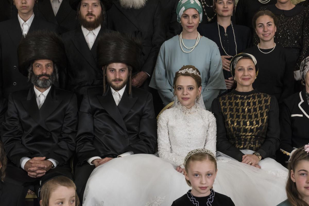 The wedding of Yanki (Amit Rahav, second from left) and Esty in 'Unorthodox.'