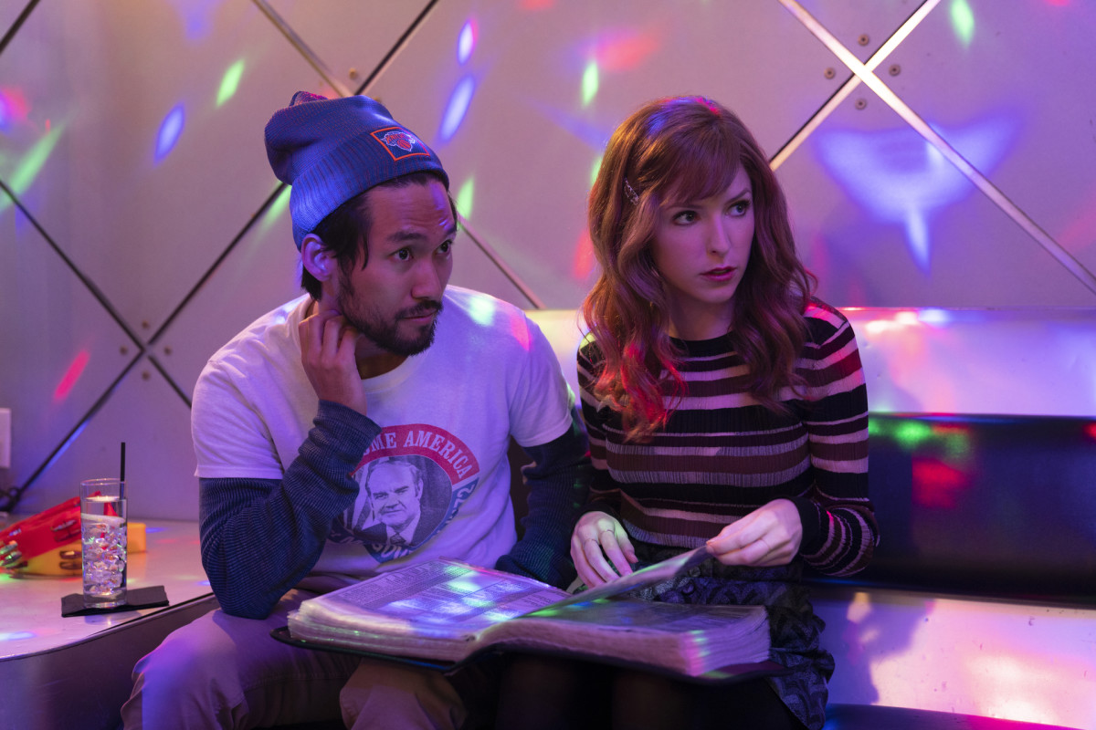 Augie (Jin Ha) and Darby (Anna Kendrick) choose their karaoke go-to.