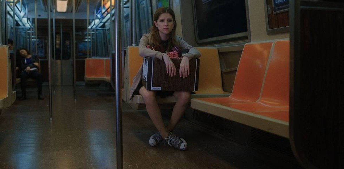 Darby's sad subway ride home in her trusty Chucks.
