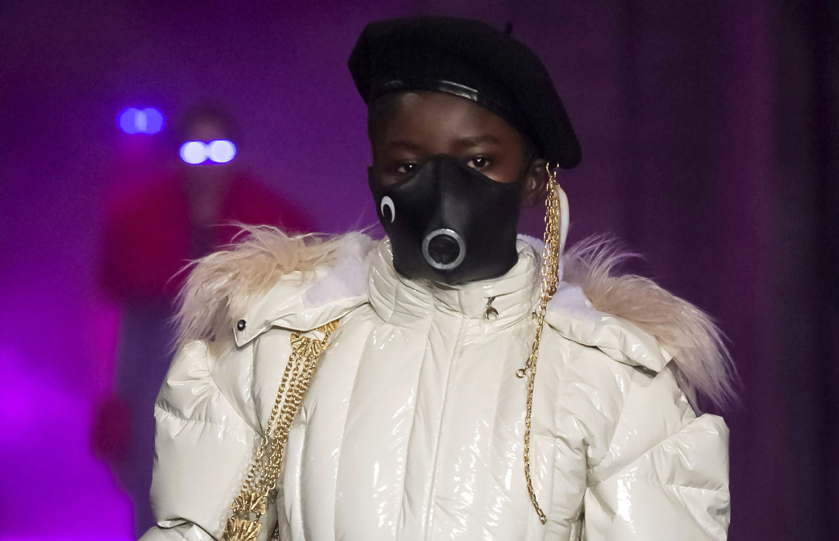 A model wearing a face mask on Marine Serre's Fall 2019 runway.