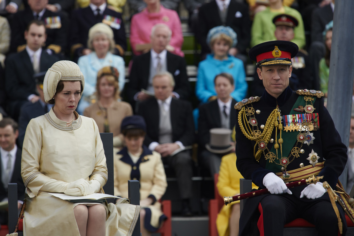 Queen Elizabeth, her hat and Prince Philip at Prince Charles's investiture ceremony.