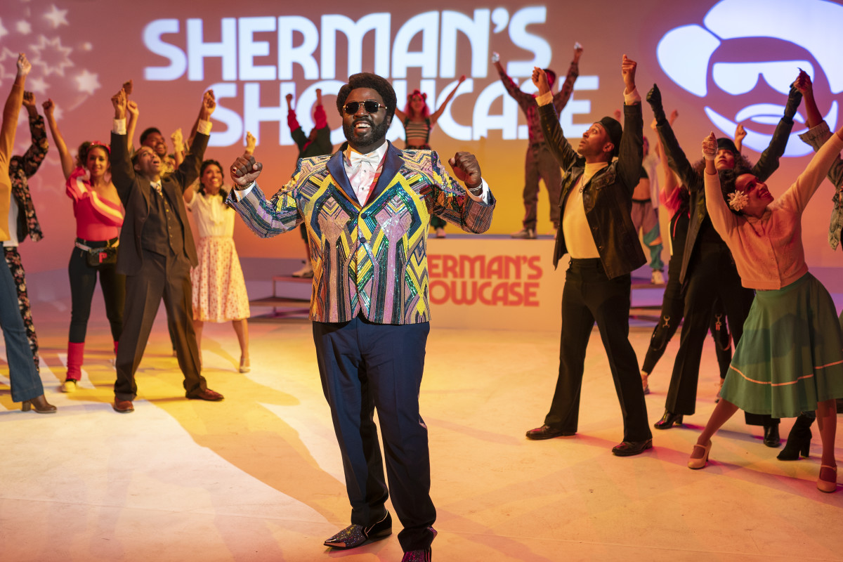 "Sherman McDaniels (Bashir Salahuddin), backed by the Showcase Dancers. ""I want them to be as famous as The Fly Girls or the Solid Gold Dancers,"" says Riddle."