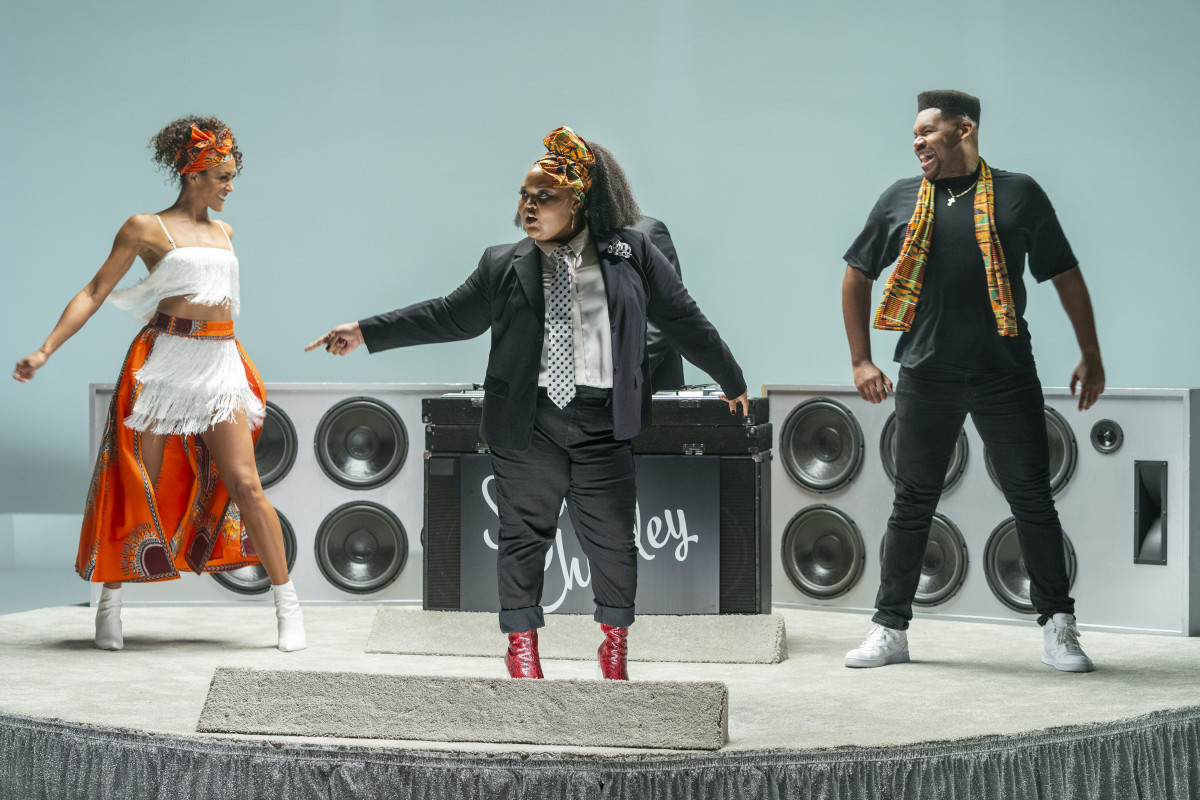 Zuri Salahuddin, backed by Showcase Dancers, sings 'Add Some Kente.'