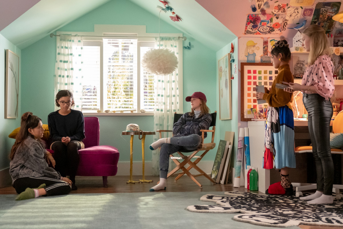 (L–R) Dawn (Xochitl Gomez), Mary Anne (Malia Baker), Kristy (Sophie Grace), Claudia Kishi (Momona Tamada) and Stacey (Shay Rudloph) wait for the landline to ring.Note the shoe-free Kishi household.