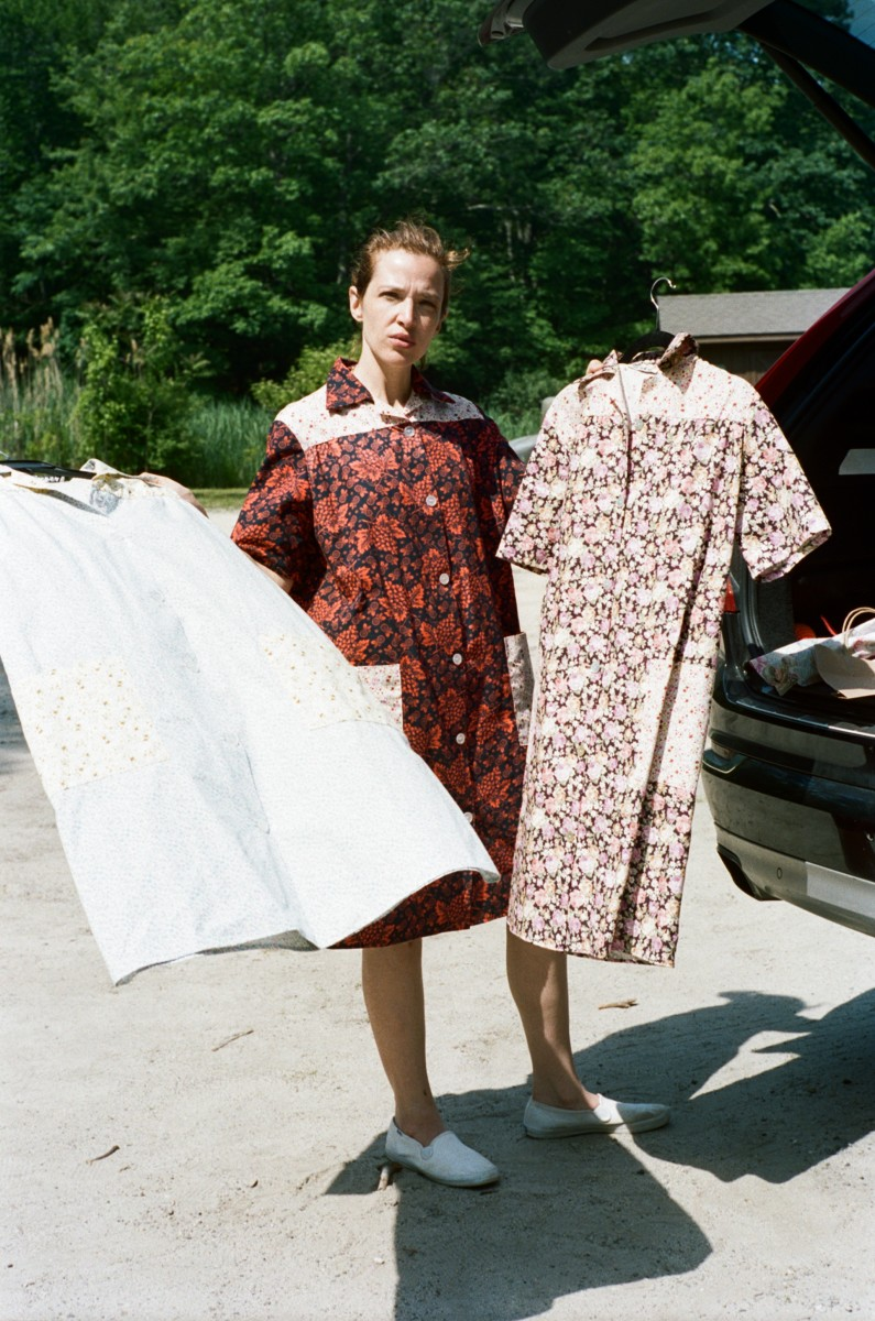Designer Batsheva Hay wearing (and holding) Batsheva's house dresses.