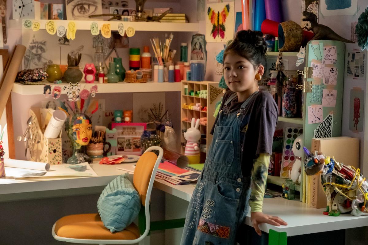Tamada as Claudia in her favorite denim overalls.