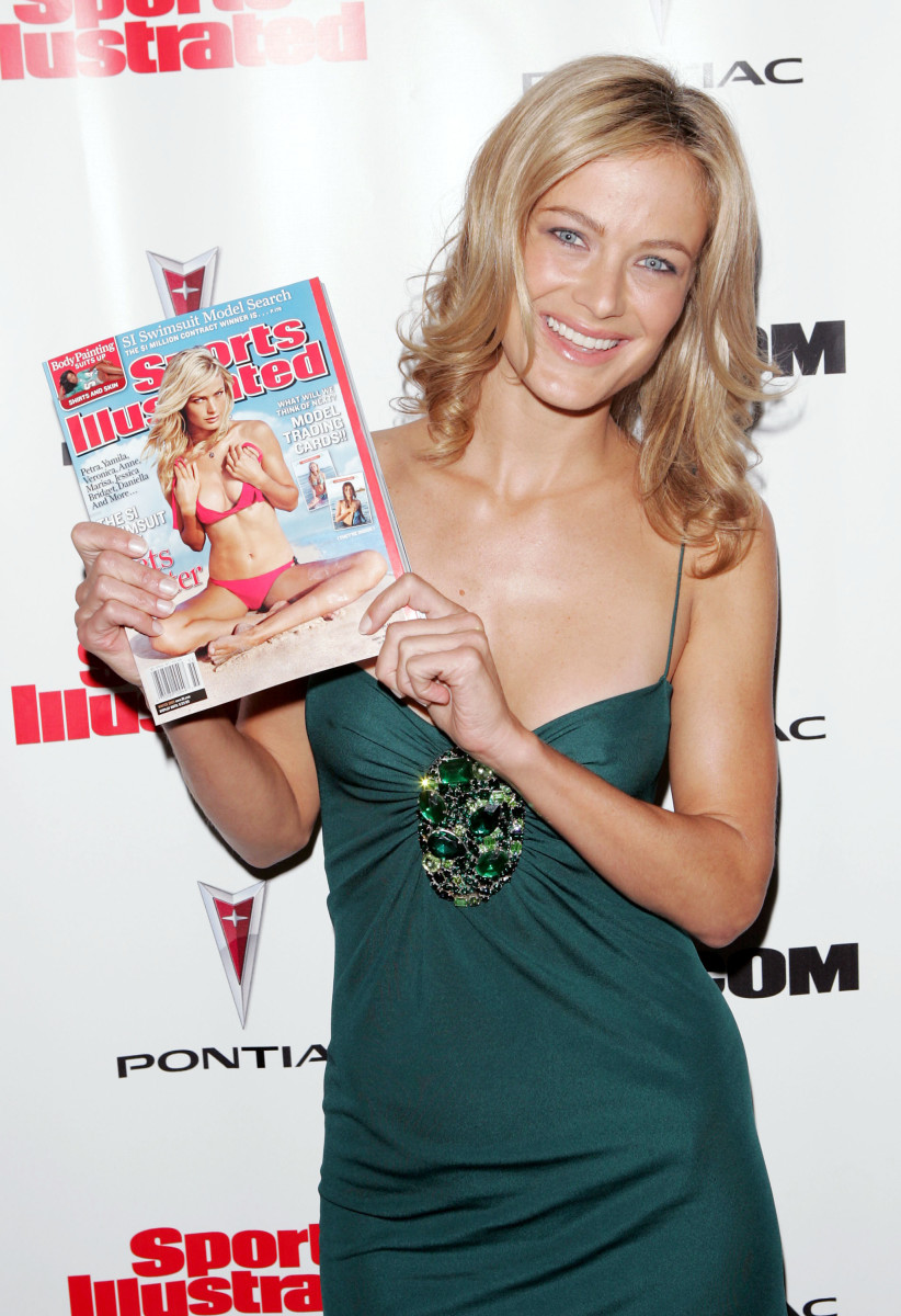 """Carolyn Murphy with her 2005 'Sports Illustrated: Swim"""" cover."""