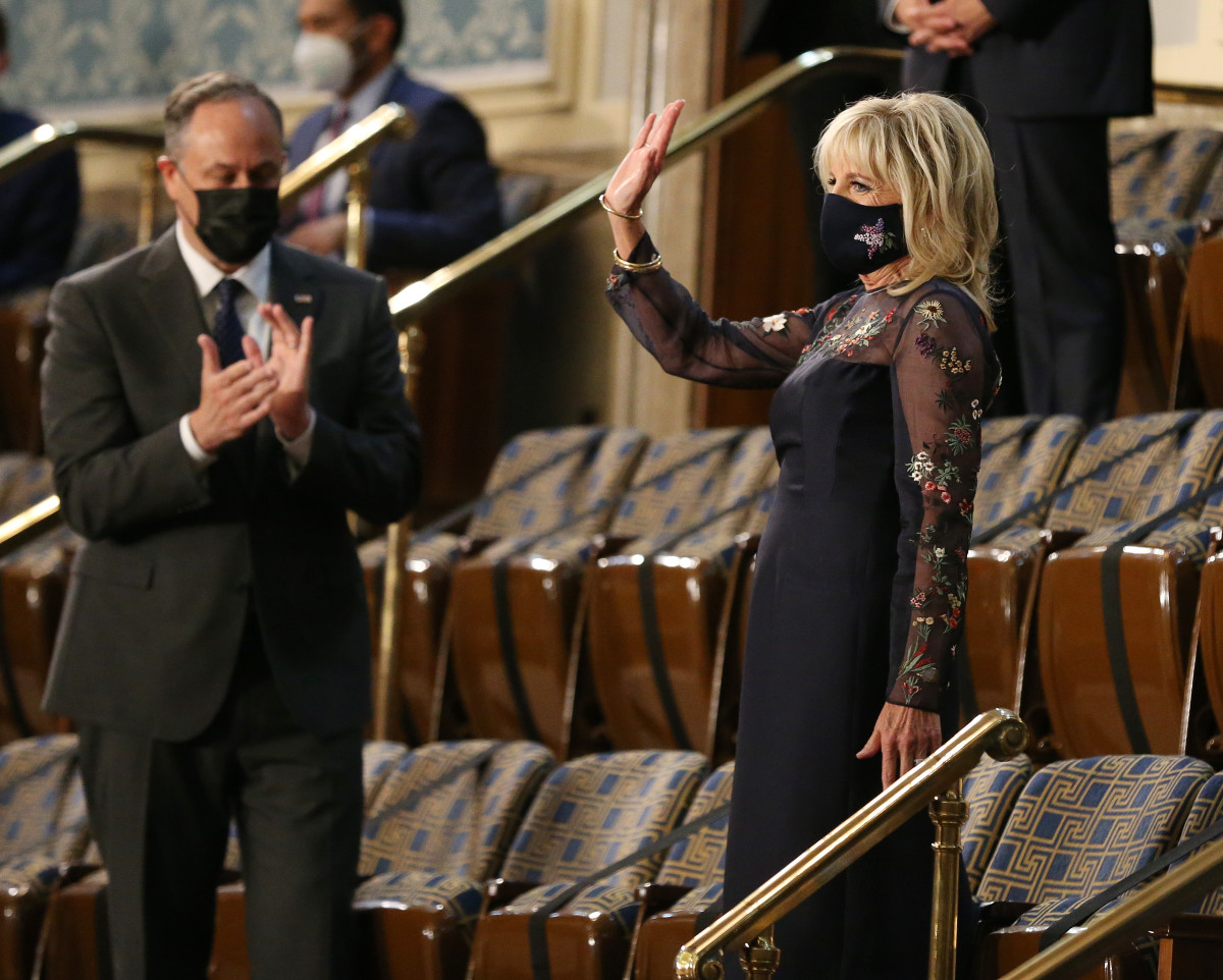 U.S. first lady Dr. Jill Biden (R) arrive before a speech by President Joe Biden to a joint session of Congress in the House chamber of the U.S. Capitol April 28, 2021