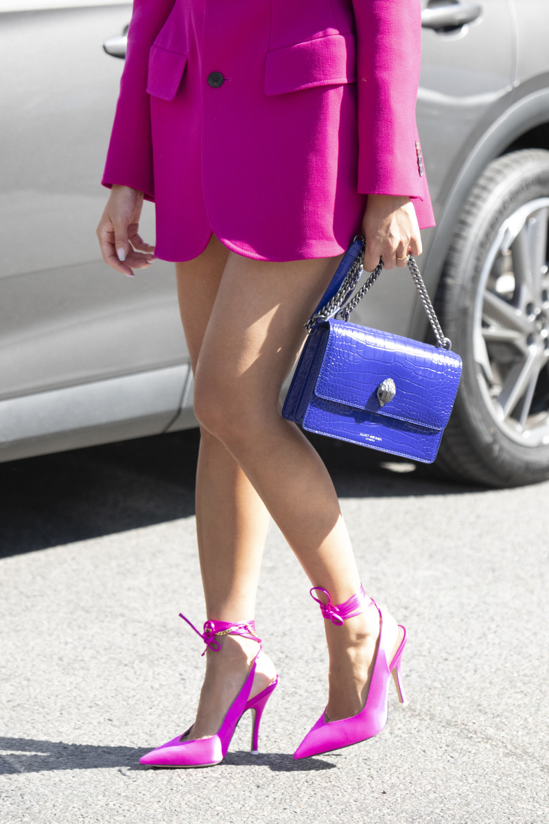 Tiffany Hsu wears The Attico shoes, Balenciaga jacket and a Kurt Geiger bag on September 15, 2019 in London, England