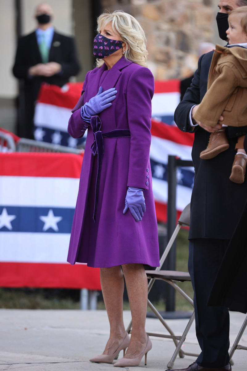 Dr. Jill Biden puts her hand over her heart during the singing of the national anthem