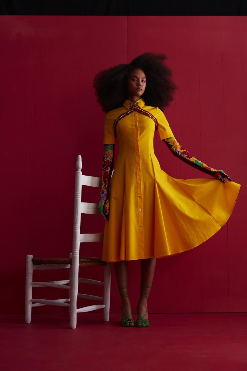 This yellow shirtdress was made using deadstock fabric from Carolina Herrera.