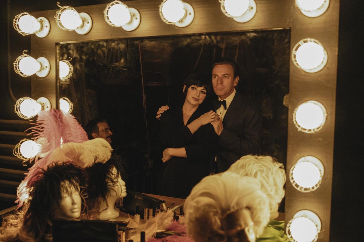 Joe Eula (David Pittu, sitting), Liza Minnelli (Krysta Rodriguez) and Halston (Ewan McGregor).
