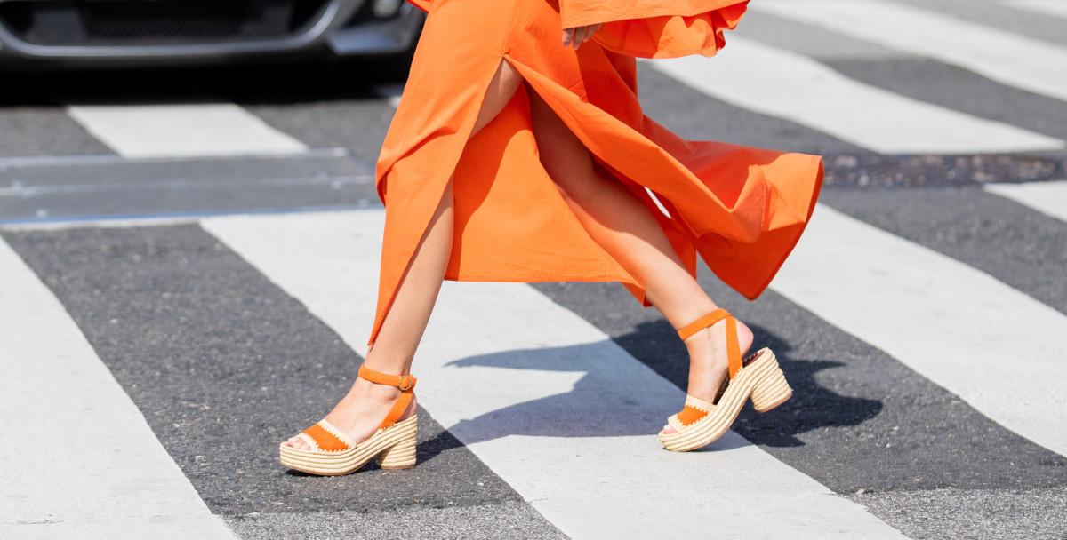 Bettina Looney is seen wearing orange dress outside Mykke Hofmann during Copenhagen Fashion Week Spring:Summer 2020 on August 06, 2019