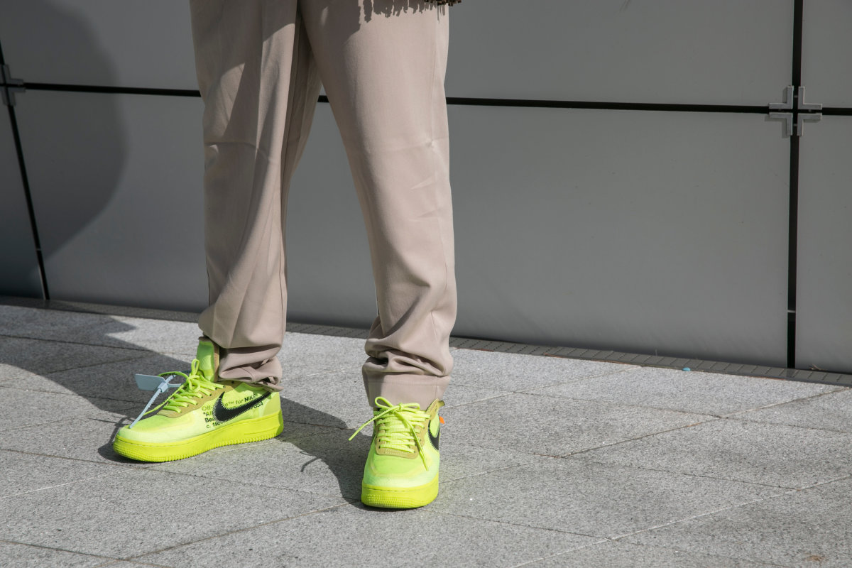 A guest is seen wearing yellow Nike sneakers during the Seoul Fashion Week 2020 S:S