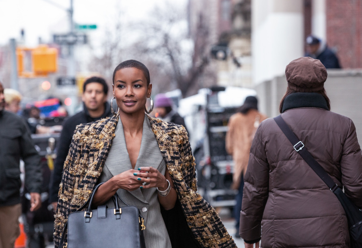 Ella (Andrea Bordeaux) is late for her first day of work in a Haider Ackerman coat and an Alexander McQueen blazer top from Patricia Field's own personal collection.