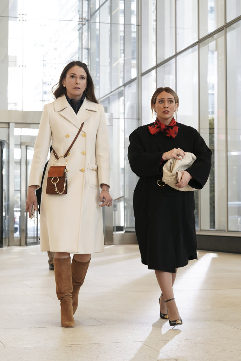Liza (Sutton Foster) in her repeated white Gucci coat and Chloe Faye mini bag and Kelsey (Hilary Duff) carrying Bottega Veneta.