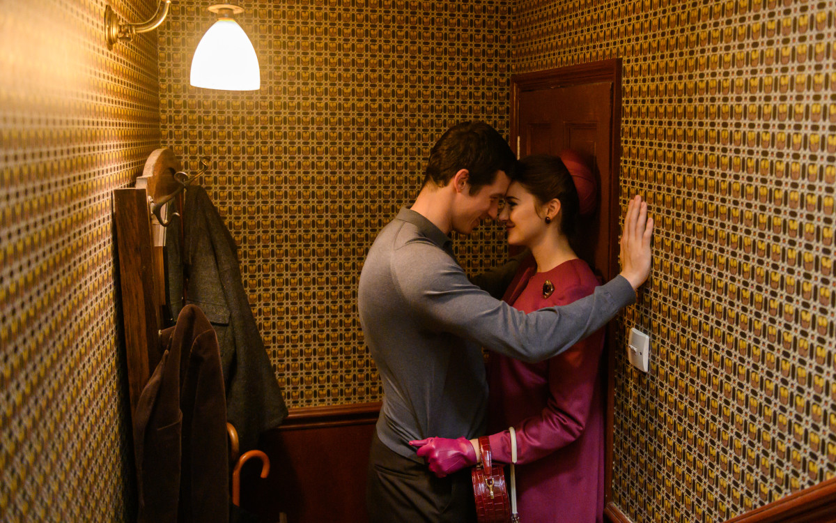 Anthony (Callum Turner) and Jennifer in one of her meticulous outfits, featuring the coat with the stunning back.