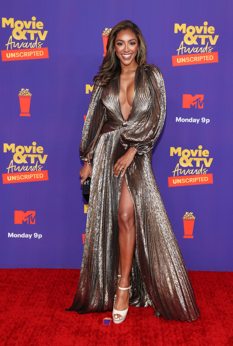Adams, wearing Oscar de la Renta (and her Neil Lane engagement ring!) at the 2021 MTV Movie & TV Awards: Unscriptedred carpet.