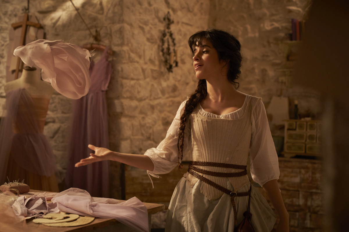 Cinderella (Camila Cabello) in her day dress and basement atelier.