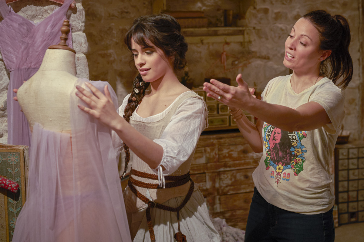 Cabello practicing her draping skills with writer-director Kay Cannon.