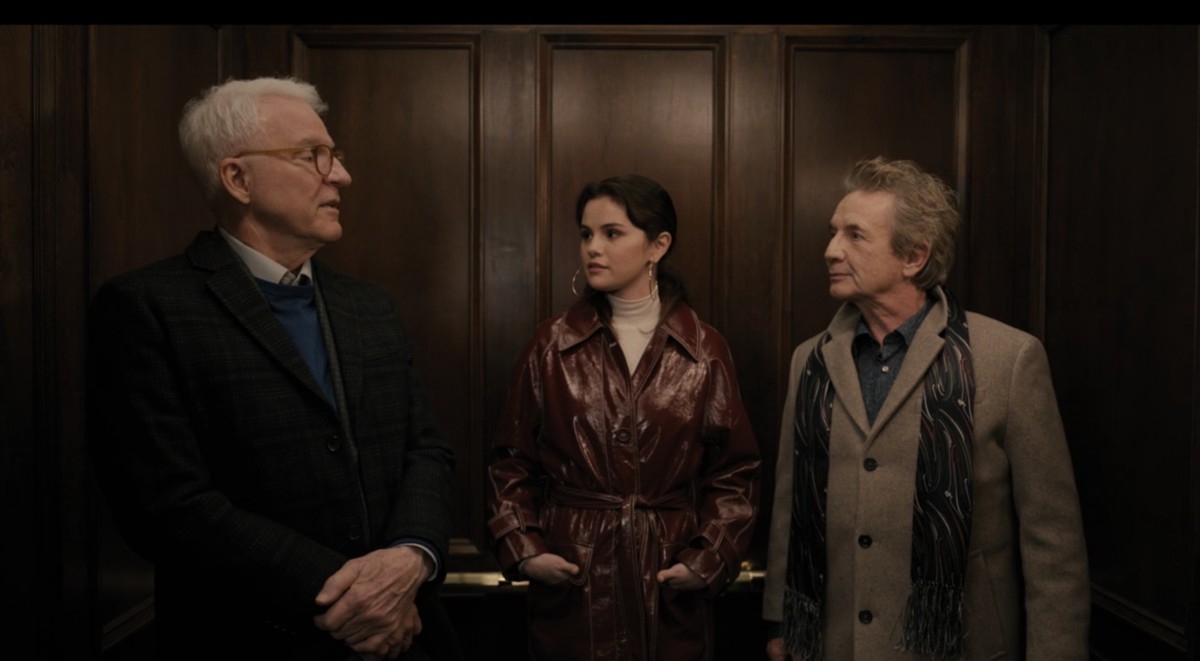Charles-Haden, Mabel in her detective trench and Oliver leave the building.